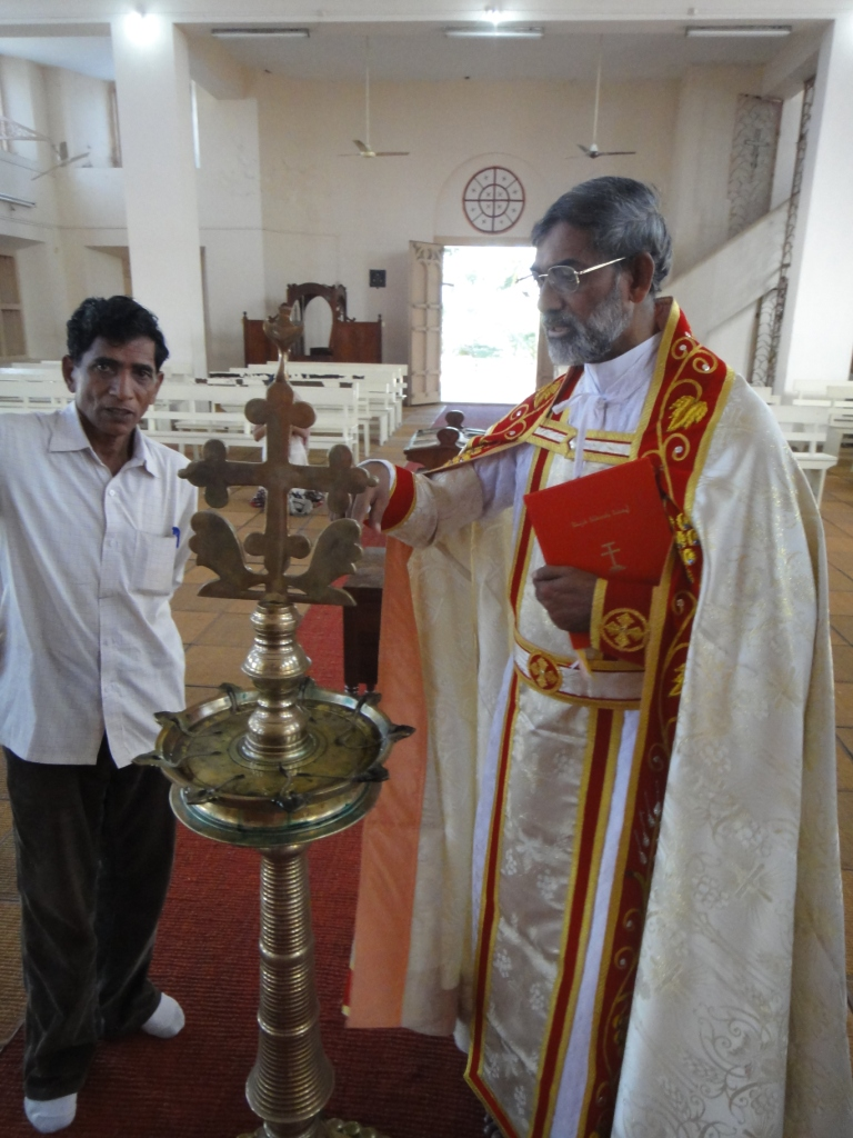 Fr. Matthew, vicar-general of the Syro-Malankara Catholic Church, showing us the local St. Thomas cross with lotus flower underneath signifying that the Cross reaches out to the whole world